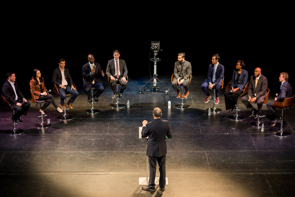 Assemblyman Michael Blake, fourth from left, speaks during a televised debate at Lehman College. Blake was joined by nine other candidates for public advocate ahead of a special election on Feb. 26.