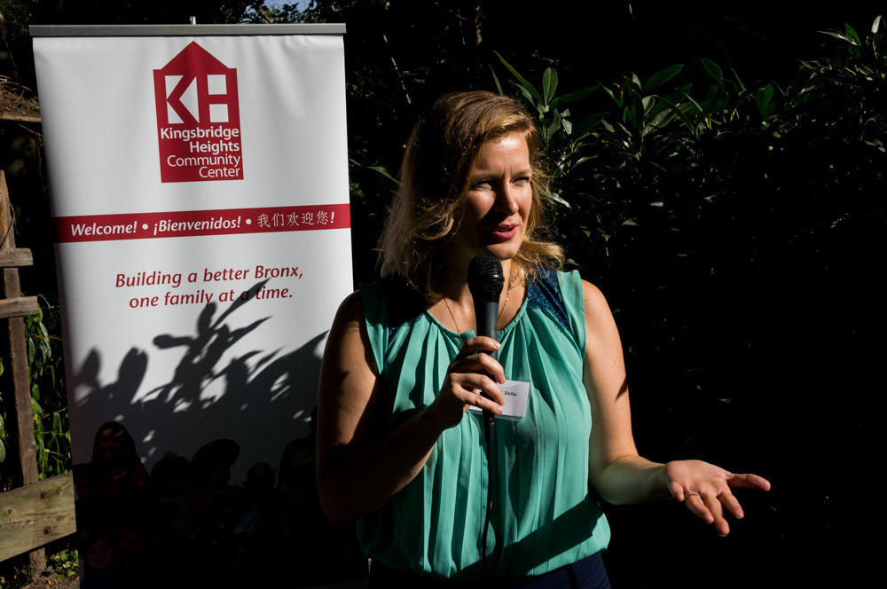 Margaret Della, executive director of the Kingsbridge Heights Community Center, speaks at the opening of the center's new park and garden space in 2017. The center celebrates its 45th anniversary this year.