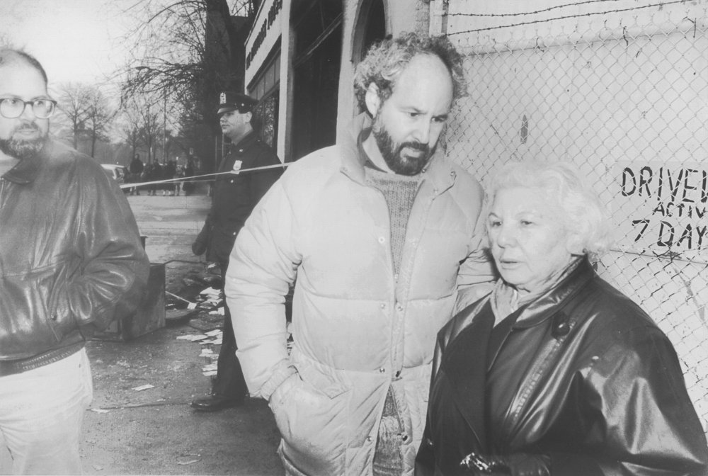 Celia Stein and sons Richie and Buddy, center, stand outside the 6155 Broadway office of The Riverdale Press in the aftermath of the Feb. 28, 1989 firebombing. Investigators at the time believed the attack was in response to an editorial written by Buddy Stein that defended the right to buy Salman Rushdie's 'The Satanic Verses.'