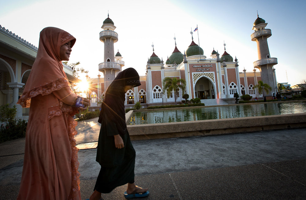 Thai girls walk past Pattani Central Mosque before evening prayers in 2015. Women in the region are encouraged to cut their daughters under the assumption it will control their sexual urges in adulthood and make them 'clean.'