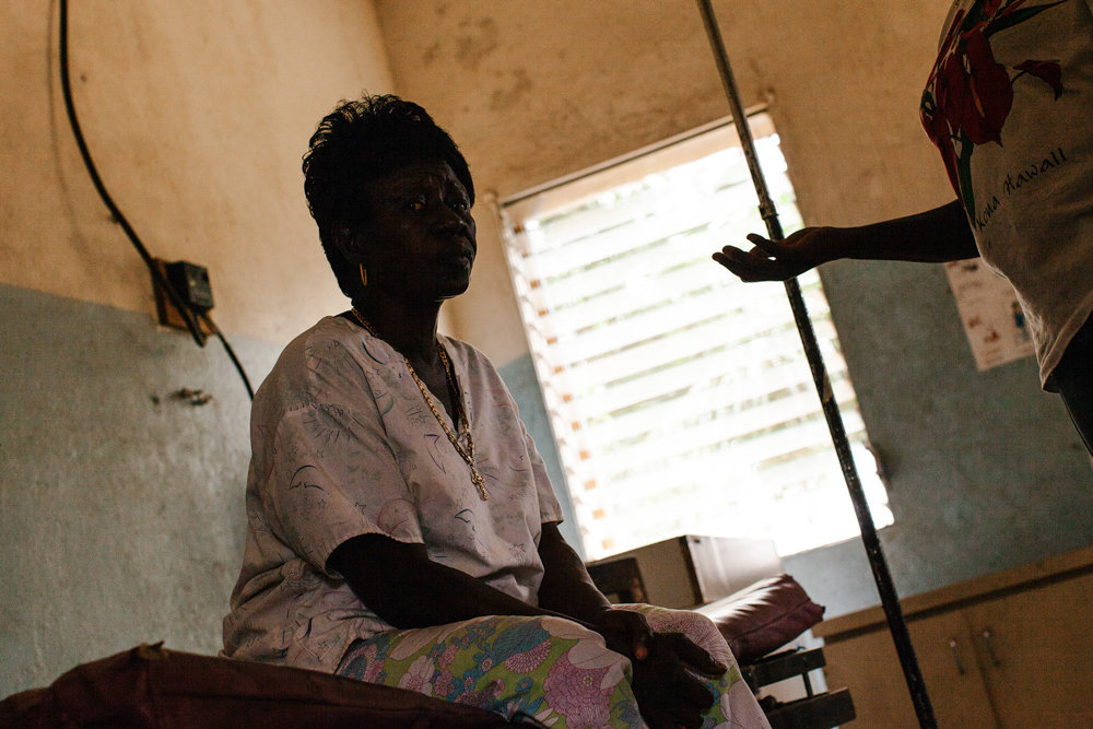 Pulitzer Center grantee Mae Azango, right, discusses the challenges of working as a midwife with Annie Gobah, a trained traditional midwife from Todee, in 2012. After one of her stories on female genital mutilation ran in FrontPage Africa, Azango received a series of threats.