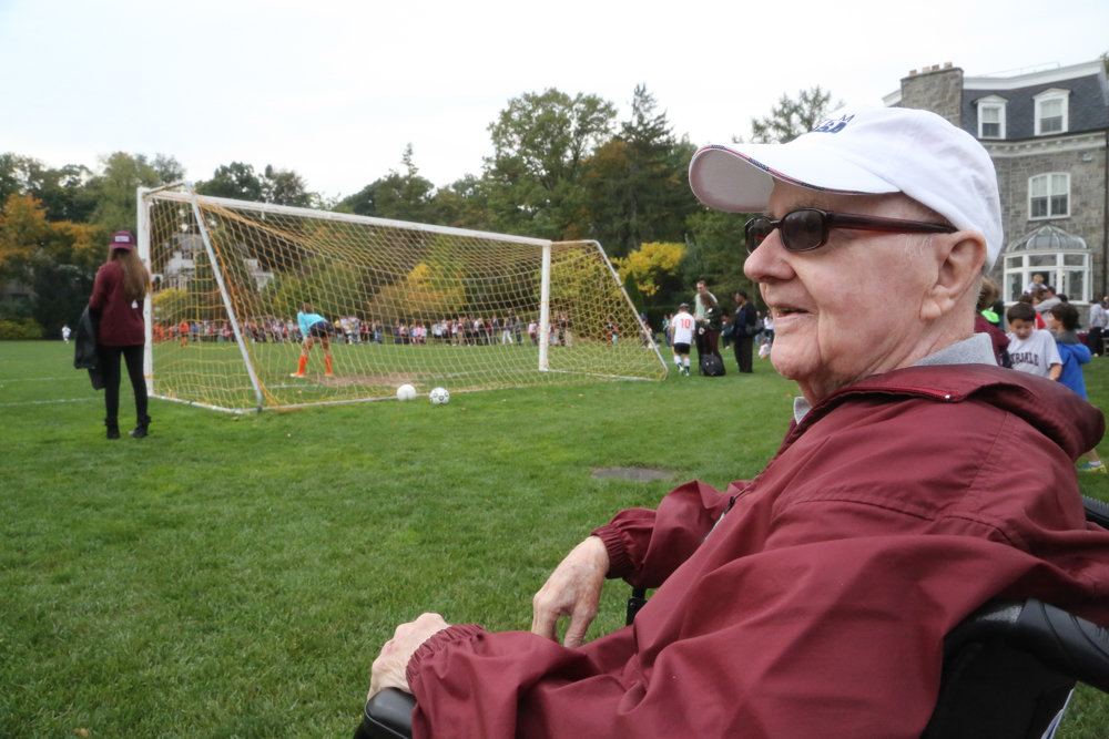 Al Davis sits outside during homecoming at Riverdale Country School in 2013. Davis worked as a physical education teacher and a coach at the school since 1953. He died Feb. 6 at 94.