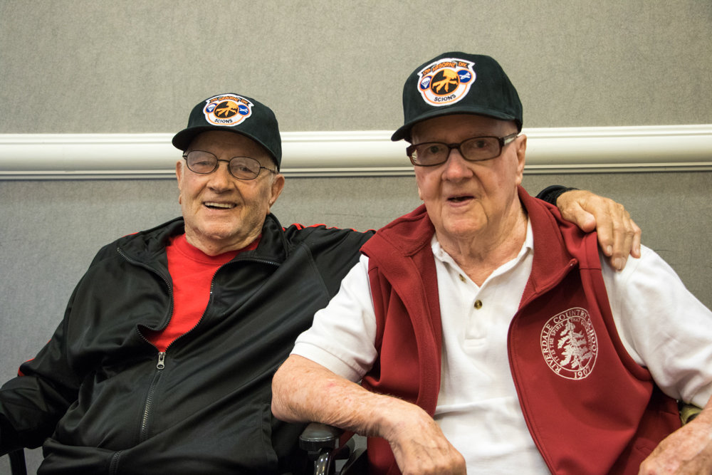 Al Davis, right, smiles with his twin brother Charles during an event honoring World War II's 17th Airborne Division in 2016 at Riverdale Country School. Al died Feb. 6 at 94.