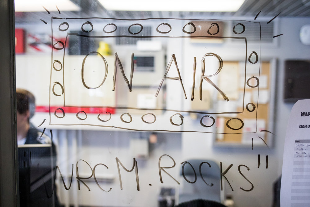'On air WRCM.rocks' adorns a window in Manhattan College's research and learning center on Corlear Avenue. The school's radio station went off the air in 2014, but is making a comeback.