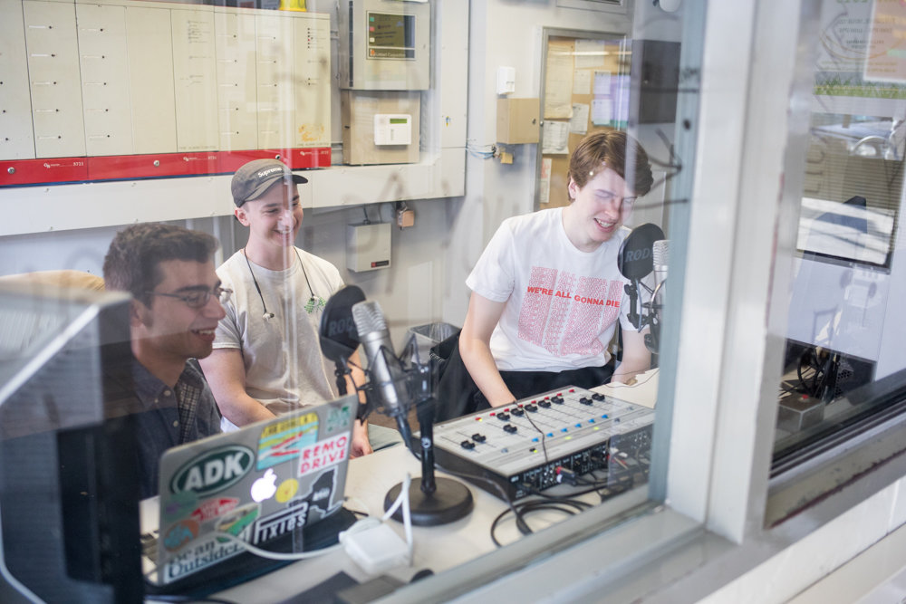 Manhattan College students Joseph Liggio, left, Joe Vaiana and Aedan Roney talk in a makeshift studio for WCRM, the school's radio station that's making a comeback five years after going off the air.