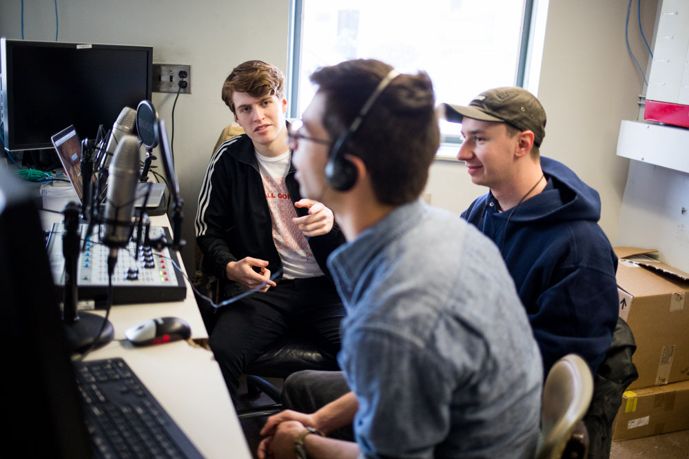 Manhattan College students Aedan Roney, left, Joseph Liggio and Joe Vaiana introduce themselves on air in a makeshift studio for WRCM, the school's recently-revived radio station.