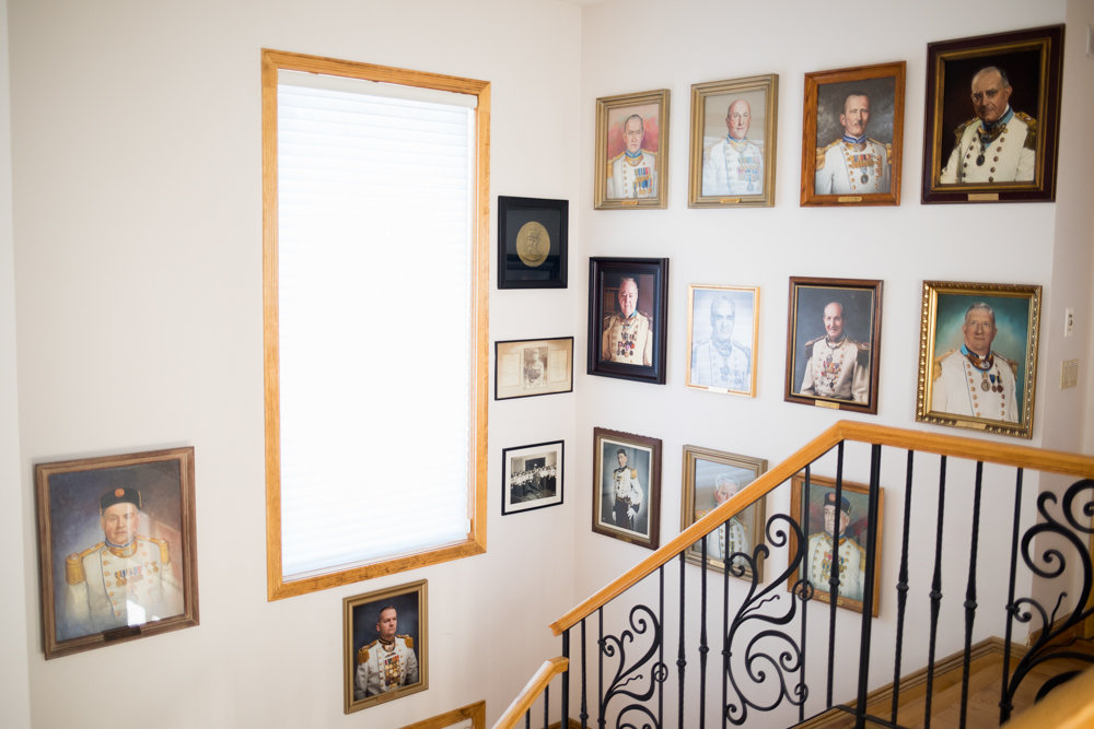 Portraits of veterans hang on walls inside the Fieldston headquarters for the Old Guard of the City of New York.