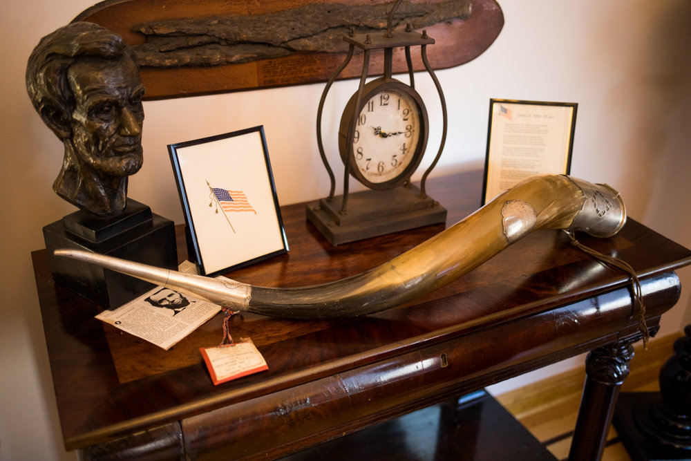 Artifacts rest on a table inside the Fieldston headquarters for the Old Guard of the City of New York. The all-volunteer veterans' organization is dedicated to preserving the state's military history.