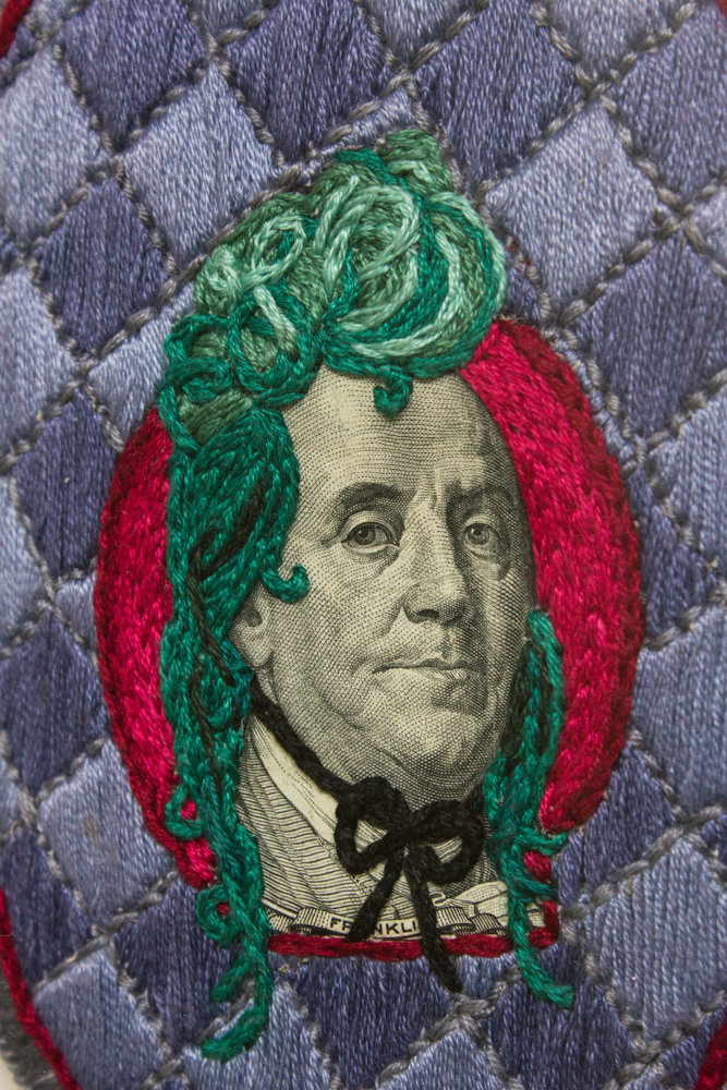 Stacey Lee Webber used real money like this $100 bill to embroider on for her series, 'The Costume Party.' Her work is on display at the Lehman College Art Gallery through May 4.