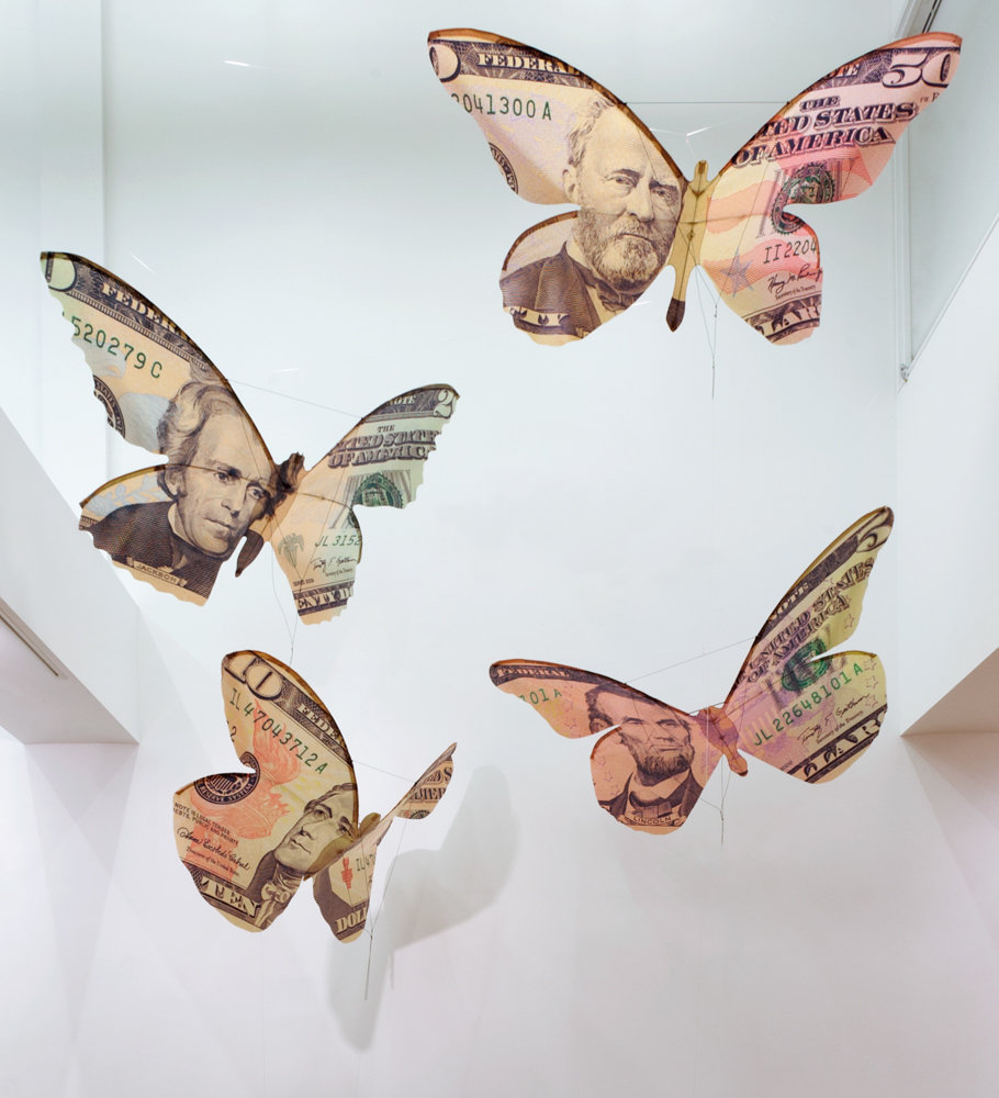 Erika Harrsch's 'Currency Kites' flies high inside of Lehman College Art Gallery as part of its 'Mediums of Exchange' exhibition exploring economic, sociological and psychological viewpoints toward money.