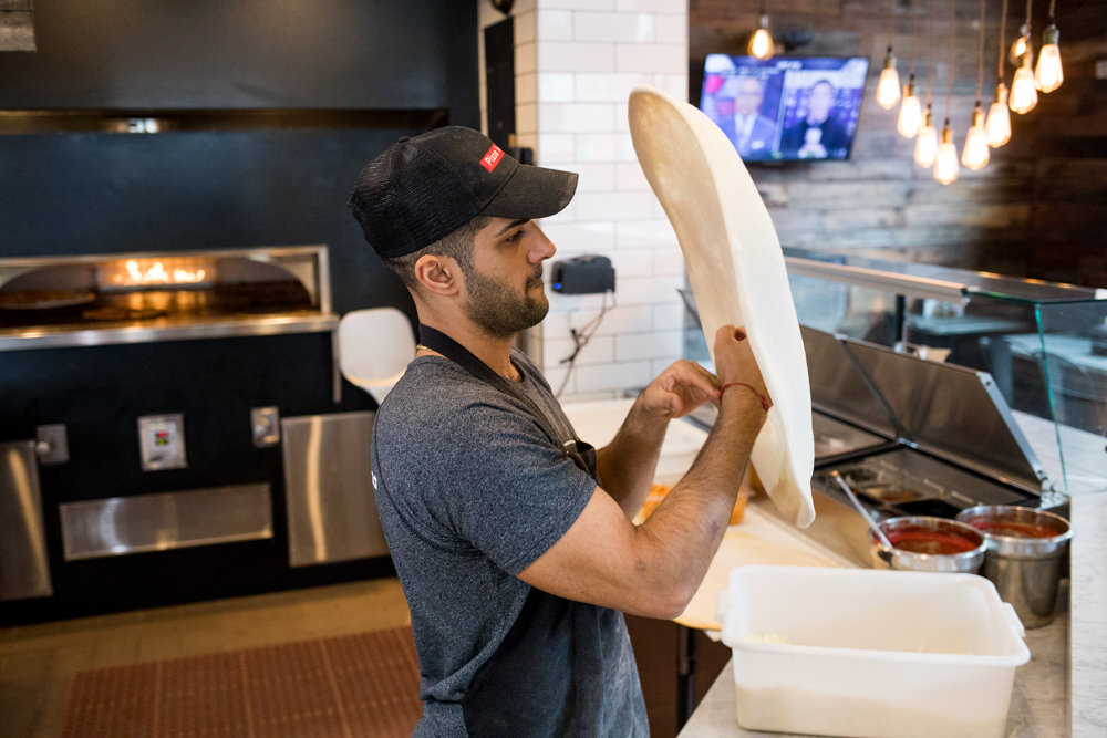 Francesco Calarco tosses pizza dough at Pizza Supreme, a new restaurant at West 242nd Street. Pizza Supreme is a recent addition to the tomato-drenched tapestry of the omnipresent, multifarious and hotly debated topic that is New York pizza.