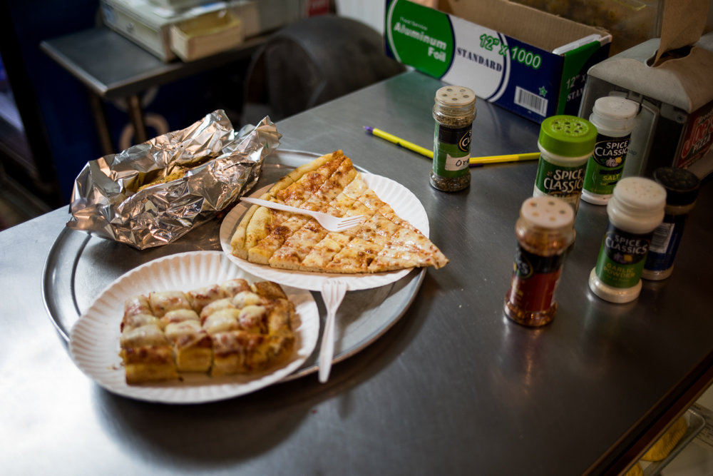 A customer's order sits on the counter at Broadway Joe's, a family-owned pizza joint that celebrates its 50th year in business this year. Owner Louis Porco took Broadway Joe's from his father Joe, for whom the establishment is named.
