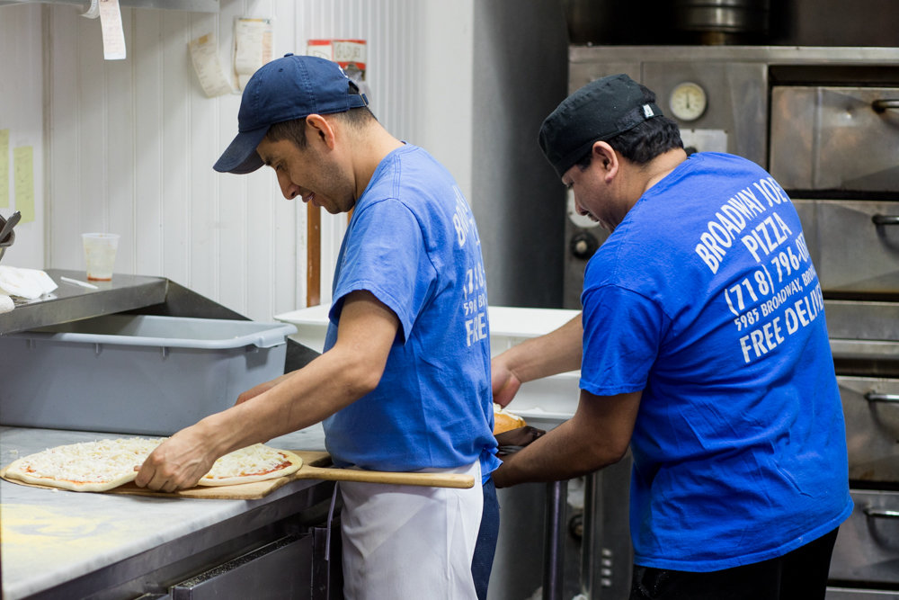 Employees at Broadway Joe's make pizzas to keep up with demand. The family-owned pie joint has been around for 50 years, and isn't going away anytime soon, according to the founder's son, Louis Porco. Joe's is part of the larger tomato-drenched tapestry of the omnipresent, highly diverse and hotly debated topic of New York pizza.