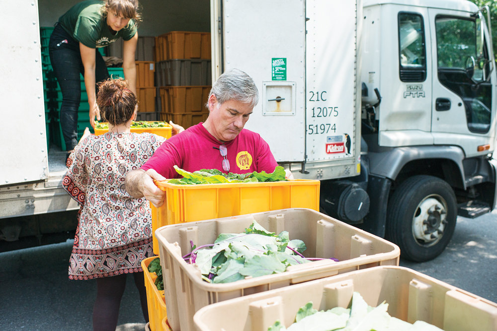 James Moloney unloads leafy green vegetables at the Riverdale Neighborhood House, a pickup location for Riverdale's community-supported agriculture program, in 2015. City council Speaker Corey Johnson is working to bring produce to the people with an interactive 'farm-to-city' map that highlights more than 300 locations where they can find some of the freshest — and affordable — fruits and vegetables around.