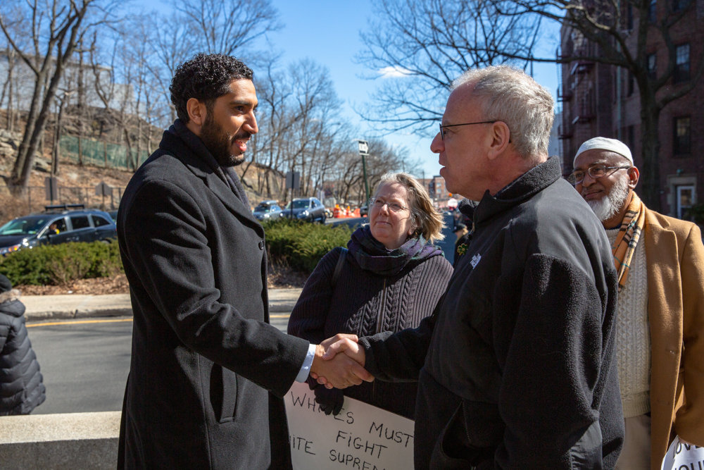 Yassine Taoufik, imam of the Abrar, shakes hands with Assemblyman Jeffrey Dinowitz at a vigil for the victims of the New Zealand massacre. Community members and religious leaders gathered at the Riverdale Monument to honor the memories of the 50 victims who died in a shooting rampage at two mosques in Christchurch on March 15.