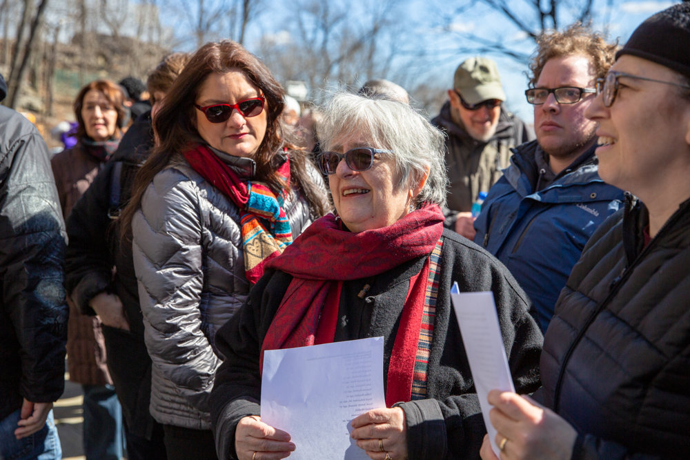 Rabbi Linda Shriner-Cahn, center, and Manhattan College religious studies professor Mehnaz Afridi attend a March 17 vigil at the Riverdale Monument for the victims of the shooting massacre at two mosques in Christchurch, New Zealand, two days before.