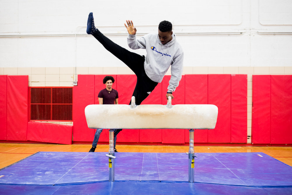 John F. Kennedy Campus senior Jermaine Da Costa demonstrates his abilities on the pommel horse. Da Costa was one of three captains for the city title-winning Knights boys gymnastics team this season.