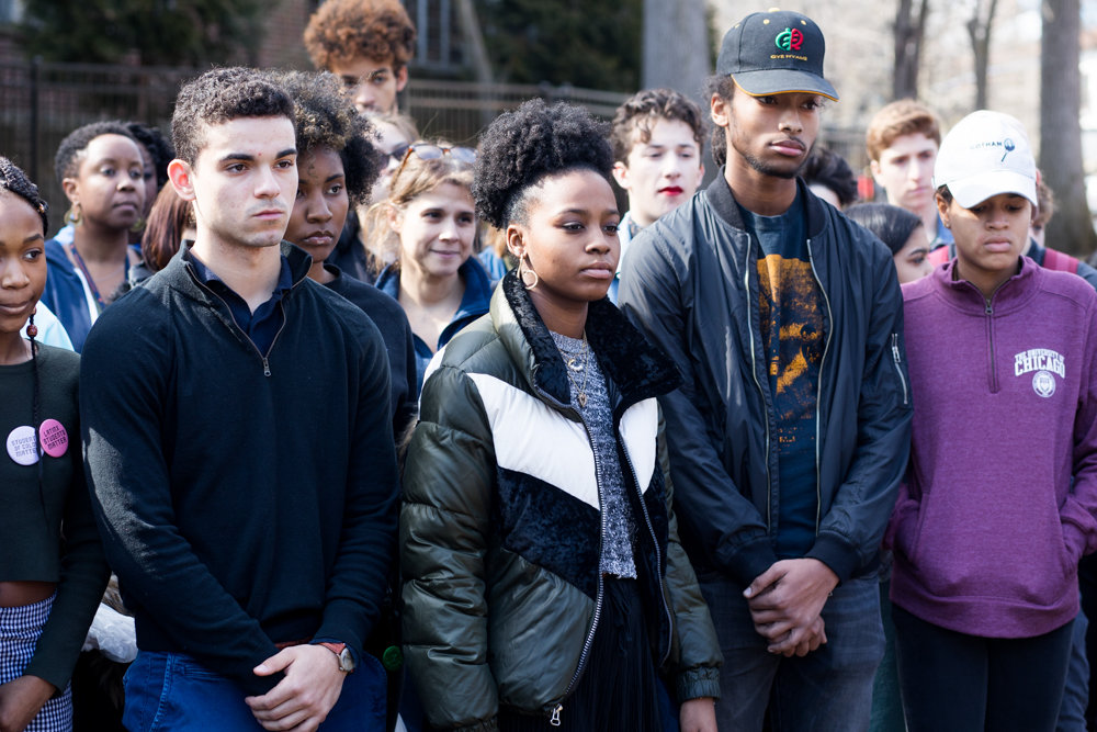 Malakai Hart, second from right in the front row, stands at a press conference on March 14 outside Ethical Culture Fieldston School following a multi-day occupation of the school's administrative building. During the lock-in, students demanded administrators take stronger steps toward addressing what some students decried as systemic racism.
