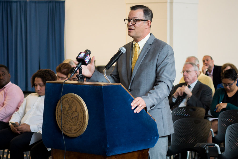 Councilman Andrew Cohen speaks out against the proposed deal with Stagg Group regarding the transitional housing facility at 5731 Broadway in 2017. Cohen's thumb is just a little less green, at least according to the New York League of Conservation Voters, after his score dropped slightly on its annual city council environmental scorecard.