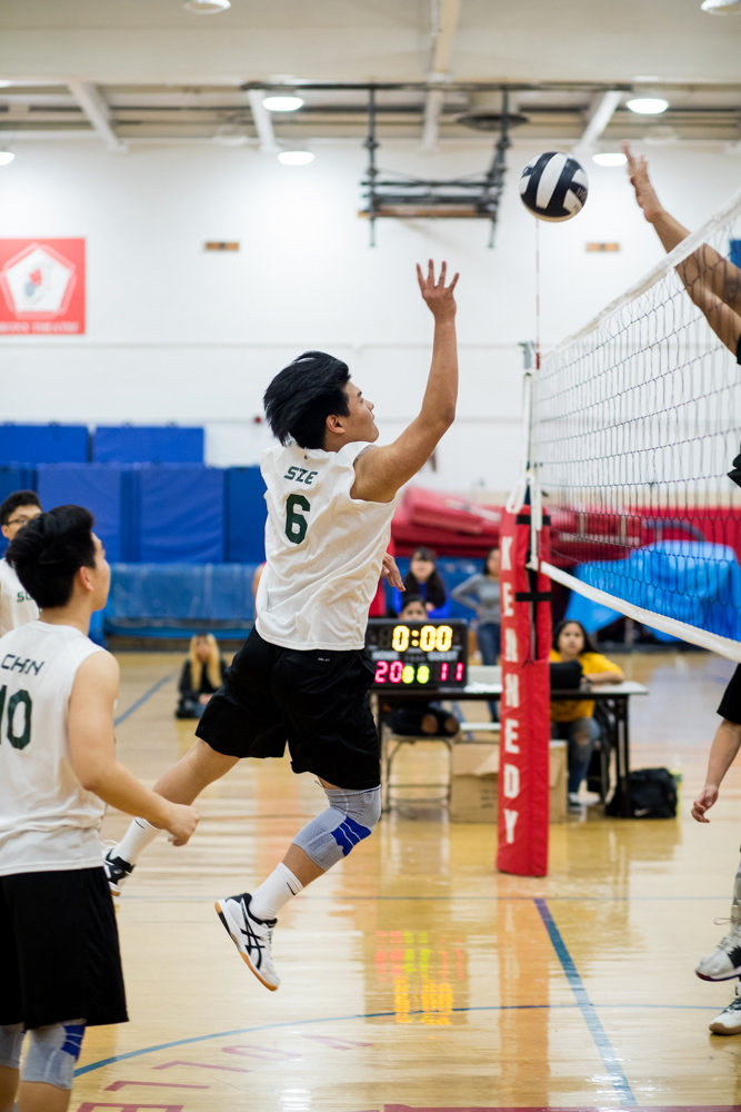Science sophomore Edgar Sze goes up for one of his three blocks in the Wolverines' straight-set victory over Clinton.