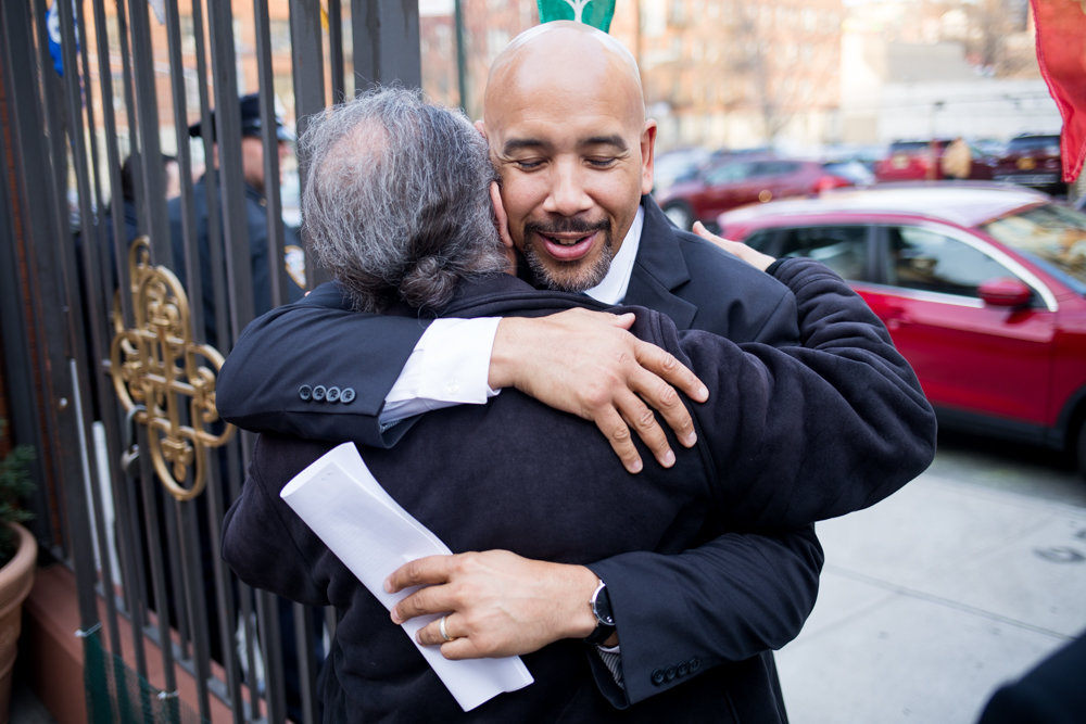Father Maximos Politis embraces Bronx borough president Ruben Diaz Jr. Diaz joined the local Greek community to celebrate Greek heritage at St. Peter the Apostle Greek Orthodox Church.
