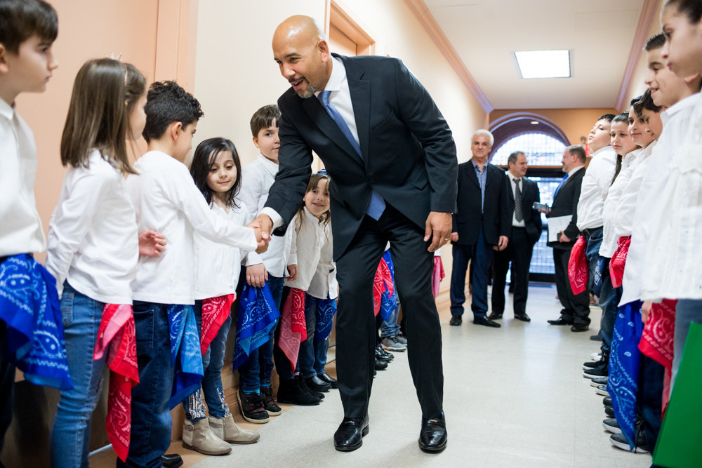 Bronx borough president Ruben Diaz Jr., at an evening celebrating Greek heritage, shakes hands with students from Evdoxia Levesanos Greek Afternoon School.