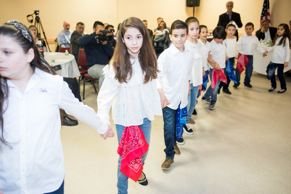 Students from Evdoxia Levesanos Greek Afternoon School dance at an evening celebrating Greek heritage at St. Peter the Apostle Greek Orthodox Church, which was attended by Bronx borough president Ruben Diaz Jr.