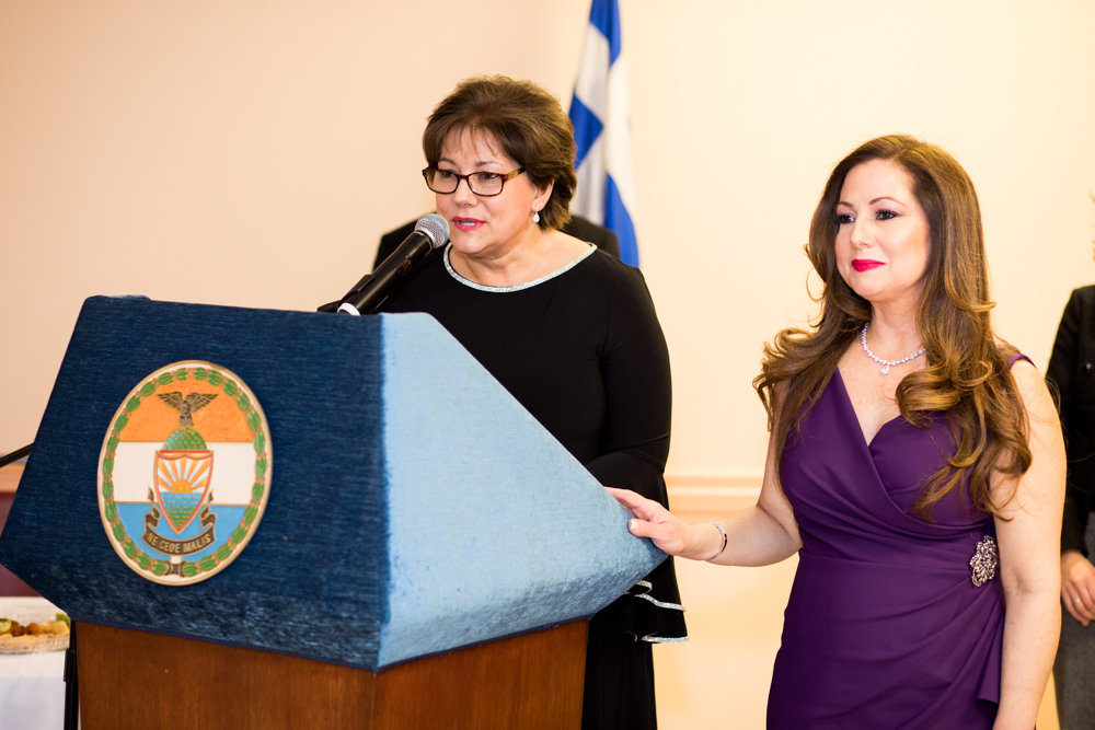 Columbia Florist co-owner Katherine Capsis expresses gratitude for being one of the night's honorees along with her sister Georgia Poulos, right, at an evening celebrating Greek heritage at St. Peter the Apostle Greek Orthodox Church.