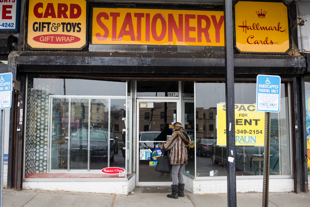A pedestrian stops briefly to take a look inside the gutted space formerly occupied by Riverdale Stationery & Candy in the Skyview Shopping Center. The shop opened in 1963, and closed last month.
