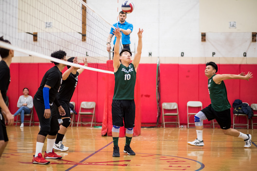 Bronx Science junior Ethan Chen prepares to set up a teammate with one of his 15 assists in the Wolverines' straight-set victory over Clinton.