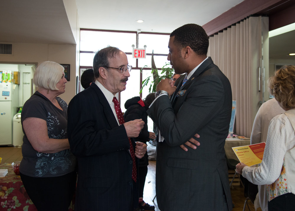 U.S. Rep. Eliot Engel speaks with state Sen. Jamaal Bailey toward the end of Northwest Bronx Indivisible's general meeting at the Riverdale-Yonkers Society for Ethical Culture.