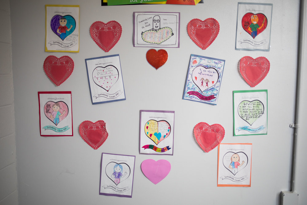 Student assignments inspired by the children's story 'Somebody Loves You, Mr. Hatch' adorn a hallway at P.S. 7. The school instituted a new curriculum geared toward students' social and emotional well-being.