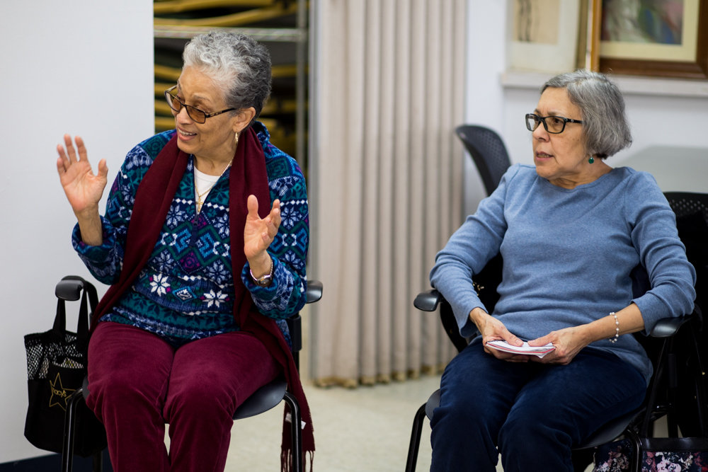 Mary Fernandez, left, talks during a meeting of the Savvy Solos Club at RSS-Riverdale Senior Services. The recently created club provides a forum for RSS members to share issues that matter to them.