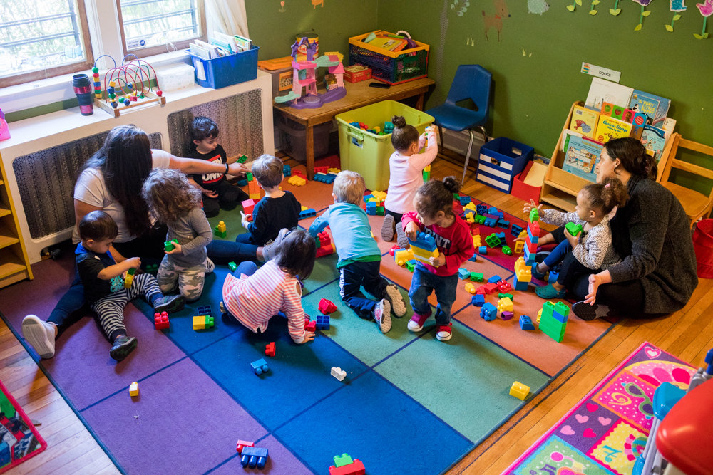 Analisa Mercado, left, and Danielle Camordy play with children at Riverdale Learn 'n Play Daycare, a home day care on West 254th Street in Riverdale. Mercado and Camordy were appalled by what happened at an unrelated facility, Maria Cortez Daycare, a Kingsbridge Heights home day care center that lost its license on May 2 after the husband of the owner was arrested for allegedly raping a child.