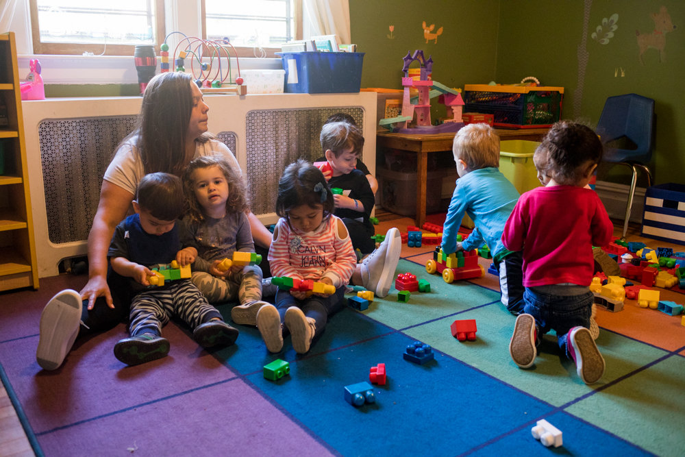 Analisa Mercado, owner of Riverdale Learn n Play Daycare, left, plays with students. Mercado was appalled by the rape allegations coming from an unrelated facility, Maria Cortez Daycare in Kingsbridge Heights, which lost its license on May 2, following the arrest of the owner's husband for allegedly raping a child.