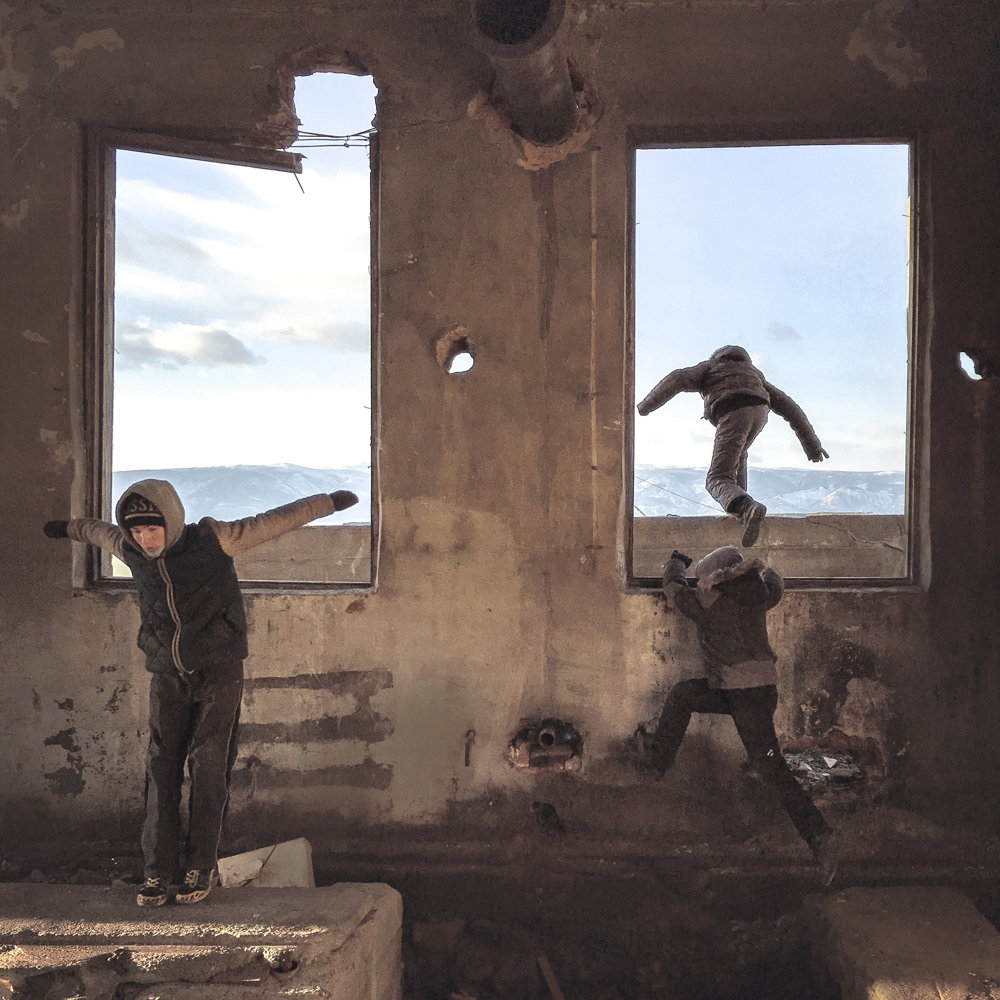 Children explore a derelict structure on the Russian island of Olkhon in a 2016 image included in 'Draft Russia,' an exhibition of Russian photographer Dmitry Markov's work on display at Agnès B Boutique Galerie through June 4.