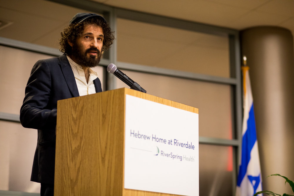 Hungarian actor Géza Röhrig shares a story during 'Write Me,' a poetry event in remembrance of the Holocaust at the Hebrew Home at Riverdale.