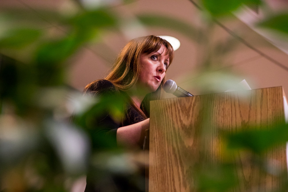 Deborah Kahan Kolb reads her poem 'Brandenburg Gate' during 'Write Me,' a poetry event in remembrance of the Holocaust at the Hebrew Home at Riverdale.