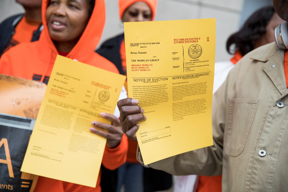 Protesters hold up mock evictions notices for landlords they say are notorious for evicting tenants in the borough, all during a rally outside the Bronx Housing Court at 1118 Grand Concourse.