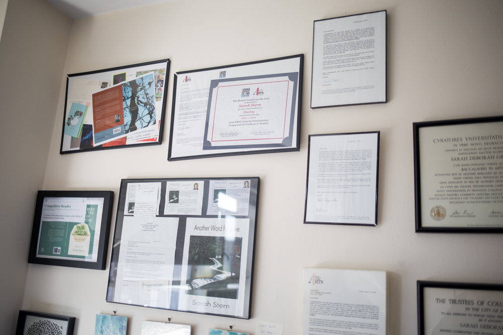 Sarah Stern has a wall of awards and recognition above the desk where she often works on her poems. Her latest poetry book, 'We Have Been Lucky in the Midst of Misfortune,' was published in December.