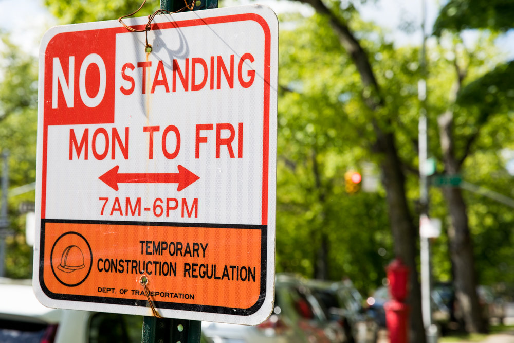 A temporary parking sign on Riverdale Avenue near West 238th Street indicates that there is no standing from Monday to Friday between 7 a.m. and 6 p.m. Just up the road, however, is an alternate parking sign for Wednesdays, which has led to confusion for motorists — and a slew of tickets. The temporary sign is in place for the duration of city design and construction department's repair work.