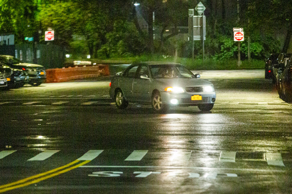 A car turns onto Independence Avenue from West 237th Street late on a Friday night.