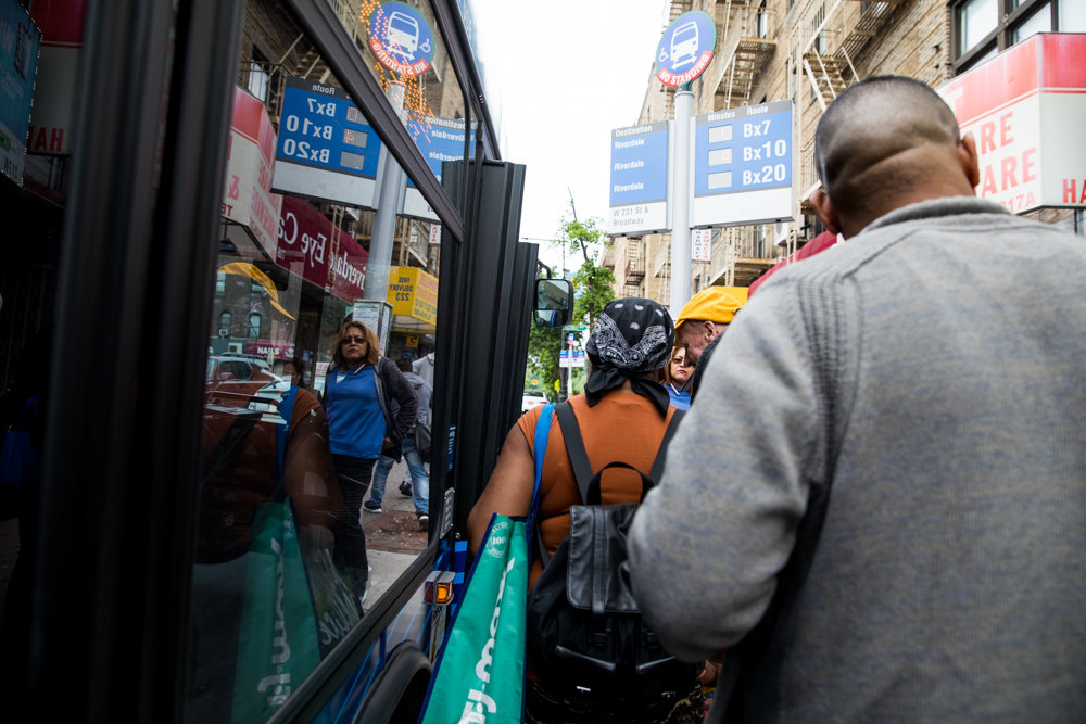 Commuters slowly board a Bx7 bus at West 231st Street and Riverdale Avenue.