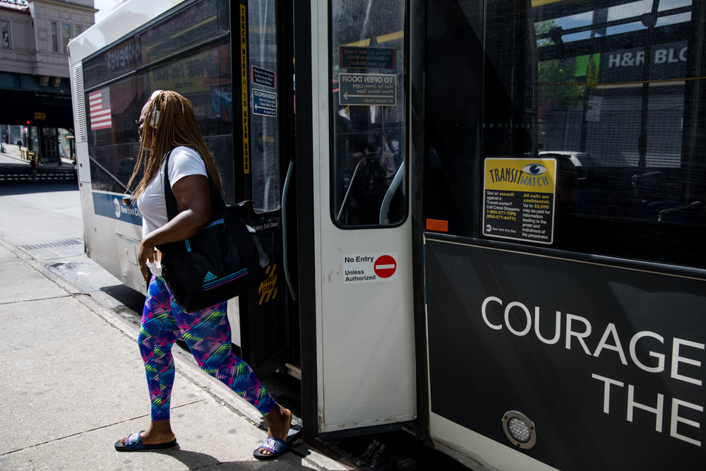 A commuter disembarks from a Bx7 bus at West 231st Street and Broadway. Ahead of a bus network redesign for the borough, transit advocacy groups have issued a list of demands they feel will improve service for commuters in the Bronx.