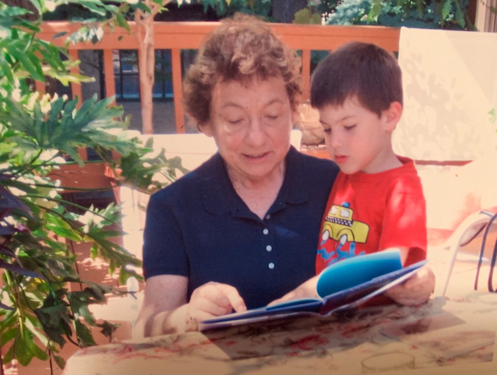 Margaret Katz reads the children's book 'Pale Male' to a child in an undated photograph. Katz, who died last year, taught for 35 years at Ethical Culture Fieldston School, and her legacy lives on in the curriculum of the Lower School.