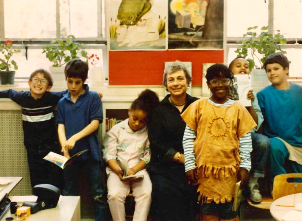 Margaret Katz, center, smiles with students in an undated photograph at Ethical Culture Fieldston School. Katz, who died last year, taught for 35 years at Fieldston, and her legacy lives on in the curriculum of the Lower School.
