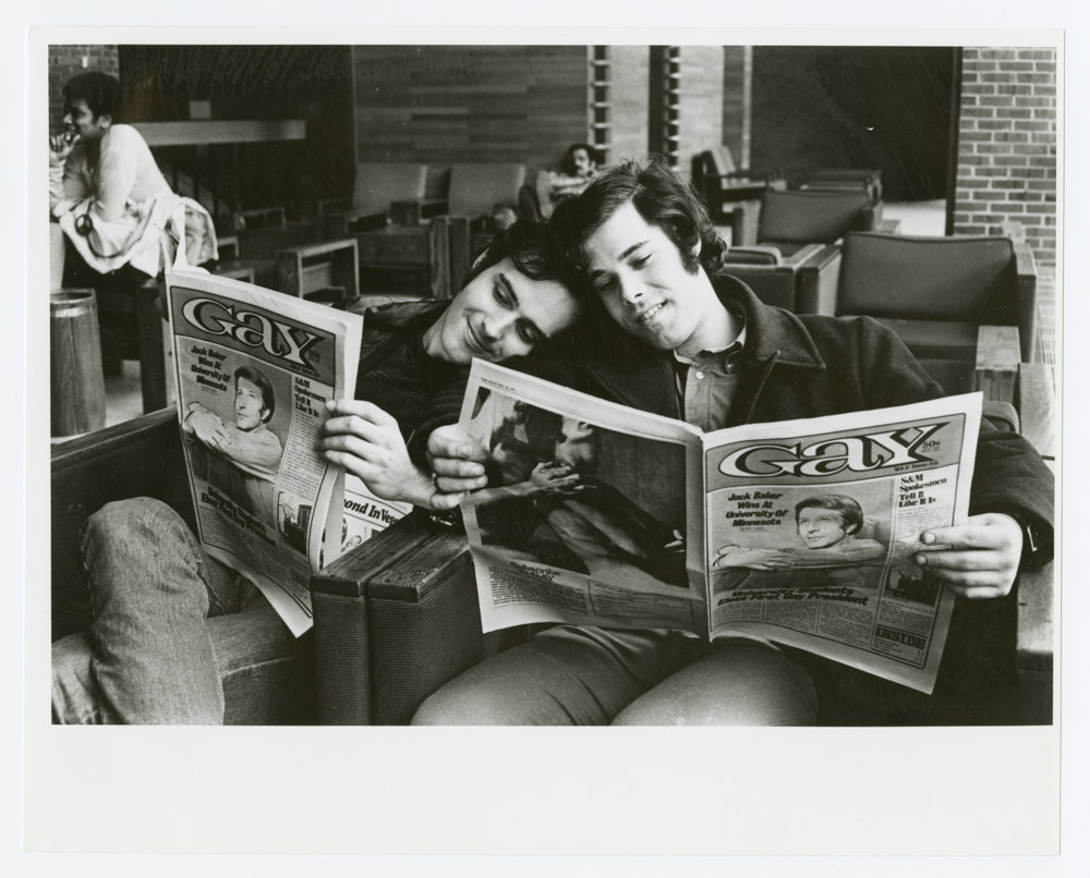 Men read Gay magazine in a 1971 photograph by Kay Tobin Lahusen. The New York Public Library is marking the 50th anniversary of the Stonewall riots with the exhibition 'Love & Resistance: Stonewall 50,' on display at the main branch through July 13.