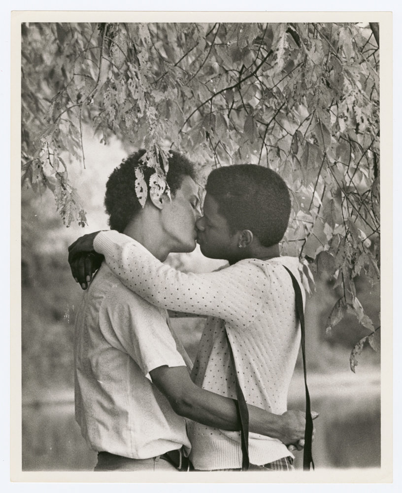 Kay Tobin Lahusen photographed two men kissing under a tree in 1977, now part of 'Love & Resistance: Stonewall 50,' an exhibition at the New York Public Library's main branch through July 13.