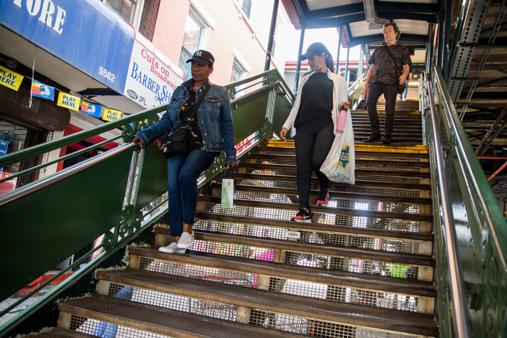Commuters walk down the stairs from the uptown 1 train at West 231st Street. Of all the 1 train stops in the Bronx, only the West 231st station is compliant with the Americans with Disabilities Act. Assemblyman Jeffrey Dinowitz authored a bill that would force the MTA to install elevators in subway stations that aren't currently accessible to people with disabilities.