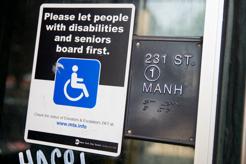 A sign urges commuters to let the elderly and people with disabilities board the elevator first at the West 231st Street 1 train station. Assemblyman Jeffrey Dinowitz authored a bill that would force the MTA to install elevators in subway stations that aren't currently accessible to people with disabilities.